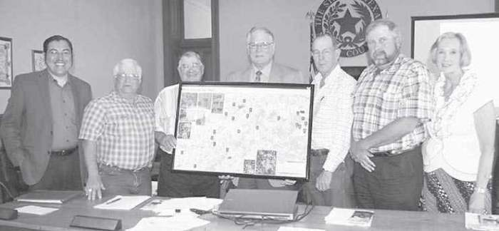 Framed maps of El Camino Real Trail presented to Milam County Commissioners.