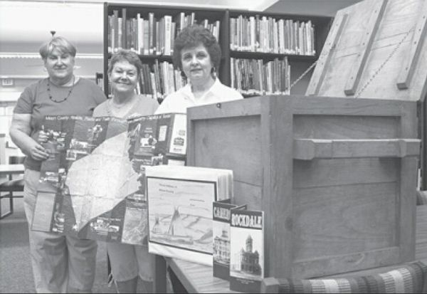 Milam County TX Historical Commission members Dolores Sonntag, Geri Burnett and Elaine Baumann show off Treasure Box